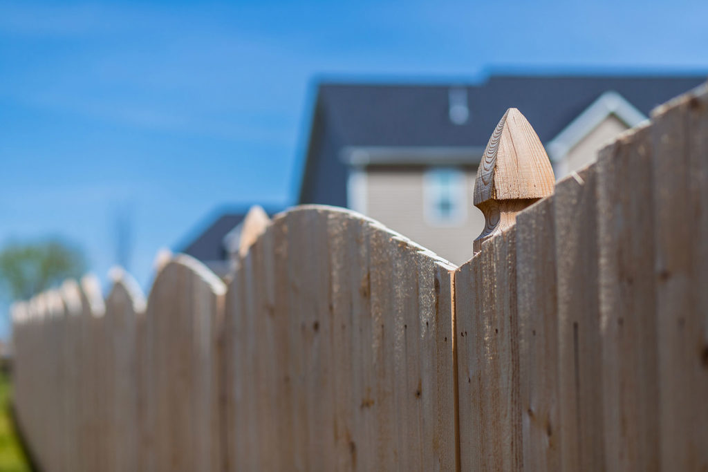 Cedar Bevel Overlap Cut Arch Fence with Cypress Lantern Post